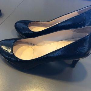 Calvin Klein black shiny pumps